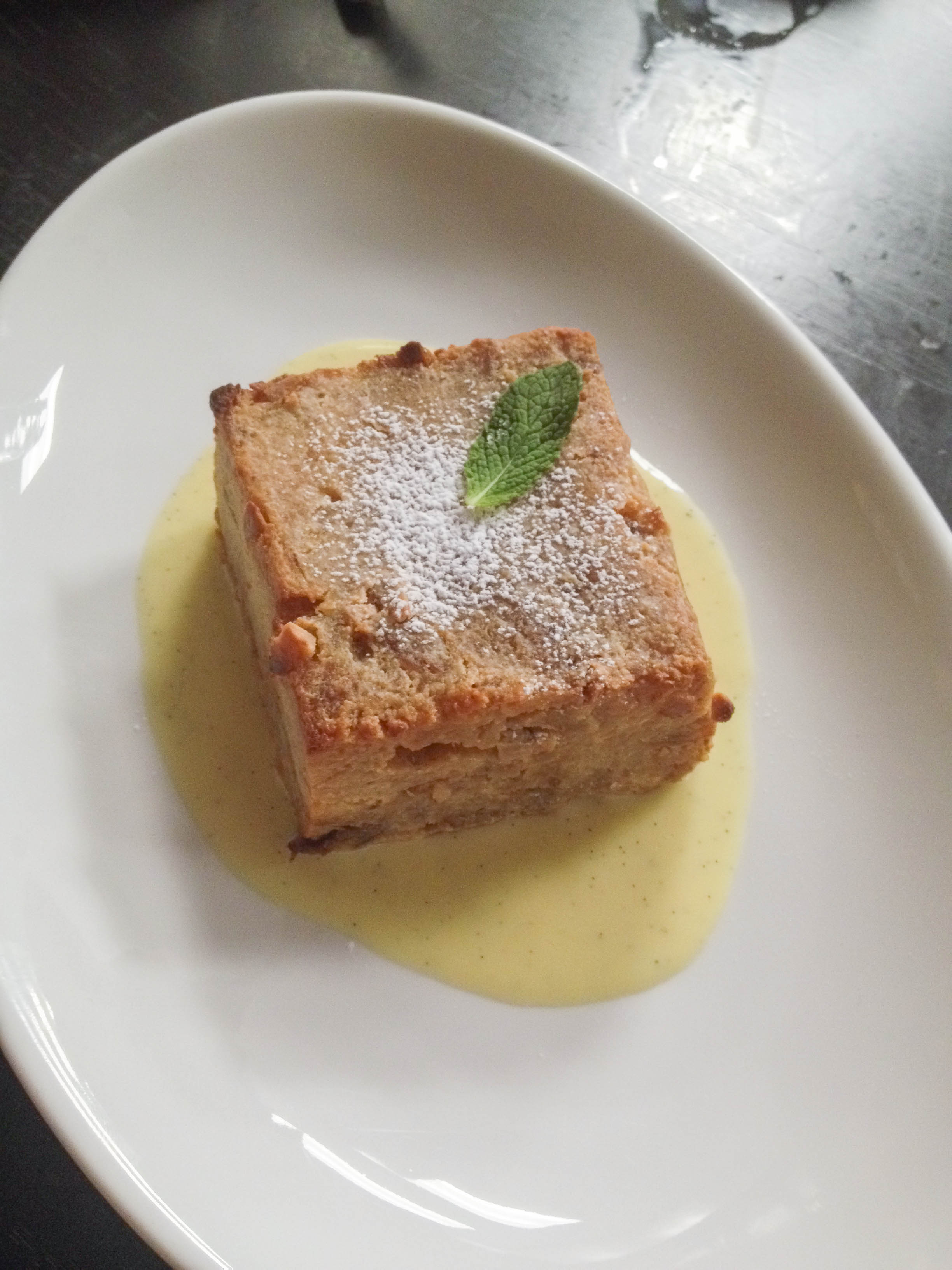 Caramelized banana bread pudding with vanilla bean creme anglaise.