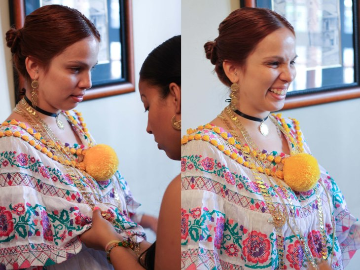 Each necklace is pinned to the blouse to ensure that it remains in the correct position.