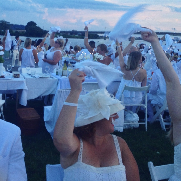The waving of napkins in the air marks the beginning of the event