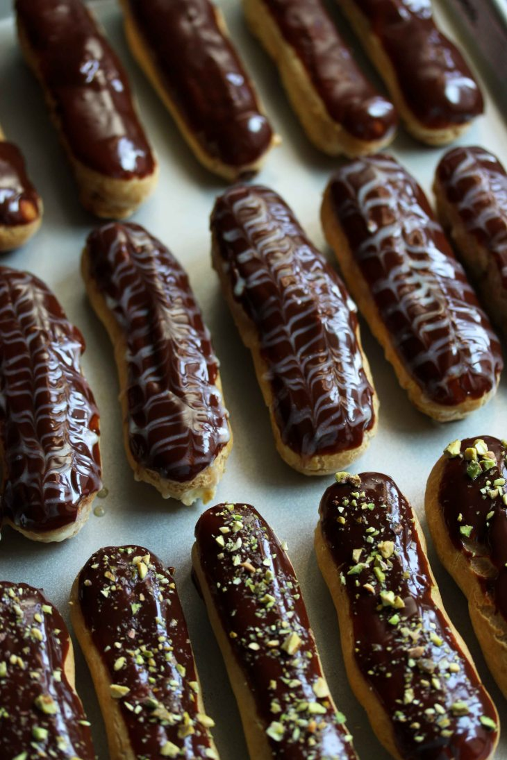 From top to bottom: chocolate, vanilla bean, and pistachio eclairs